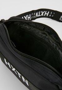 HXTN Supply - PRIME - Taška spříčným popruhem - black - 4