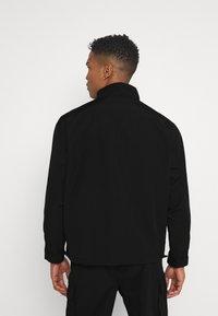 Mennace - CRINKLE TECH TRACKSUIT JACKET - Summer jacket - black - 2