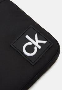 Calvin Klein - FLAT PACK  - Across body bag - black - 4
