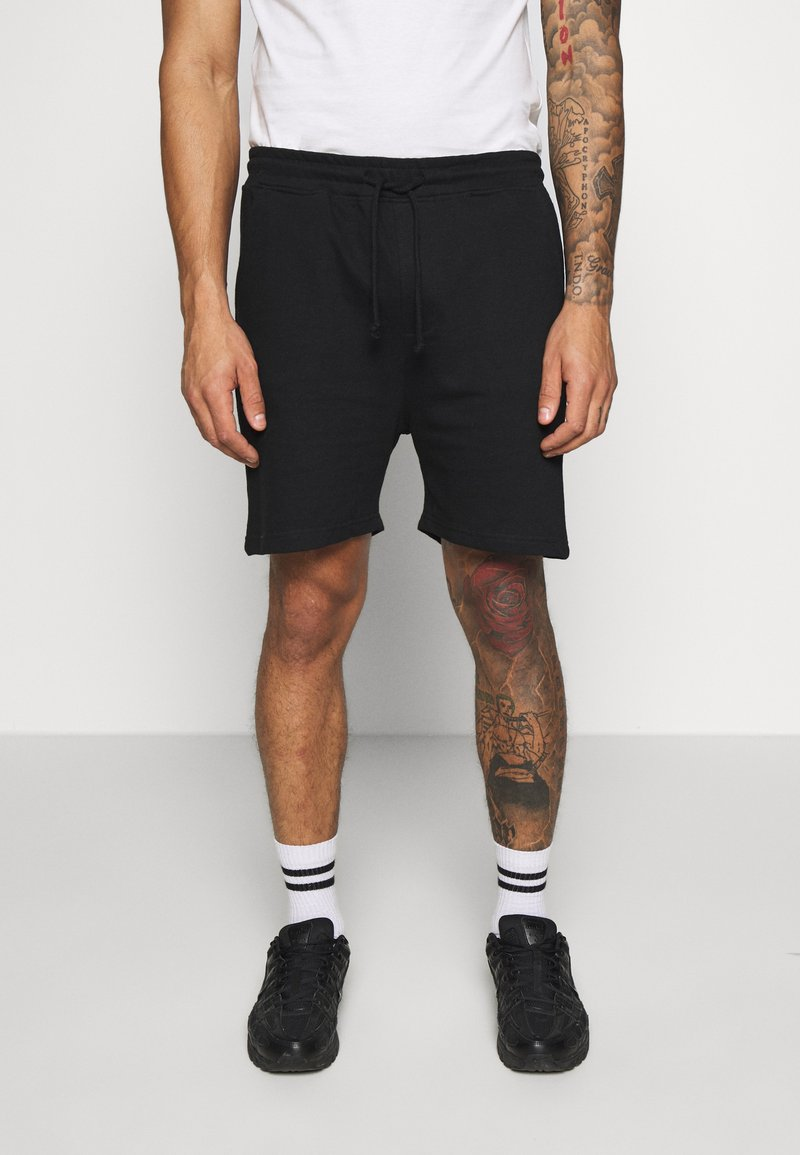 Another Influence - RELAXED FIT  - Tracksuit bottoms - black