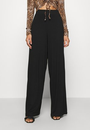 FLOW PANTS - Trousers - black