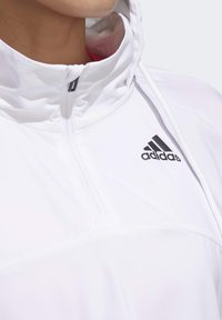 adidas Performance - ACTIVATED TECH WINDBREAKER - Windbreaker - white - 7
