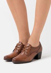 Jana - Ankle boots - cognac - 0