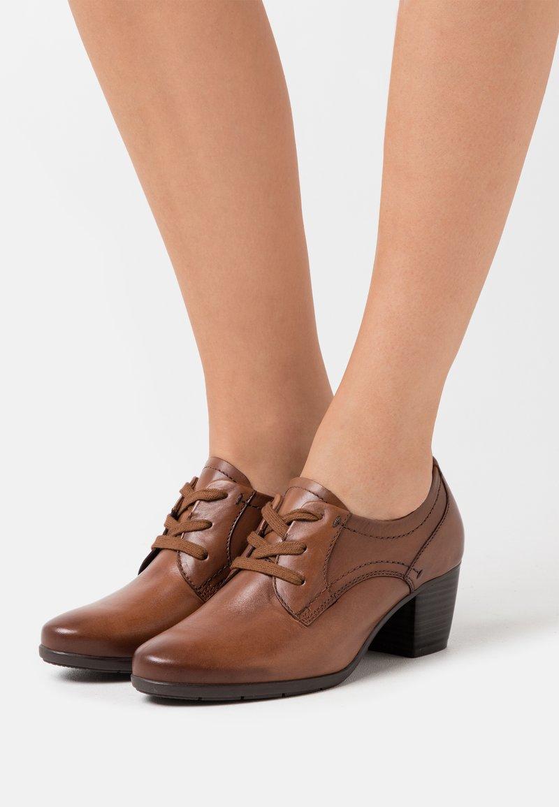 Jana - Ankle boot - cognac