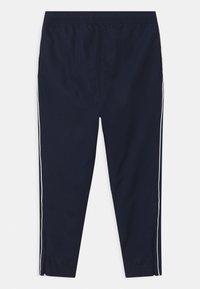 Lacoste Sport - TENNIS UNISEX - Tracksuit bottoms - navy blue/white - 1