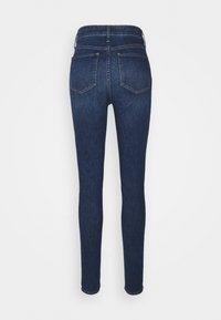Gap Tall - UNIVERSAL WALKER - Jeans Skinny Fit - dark indigo - 1