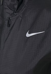 Nike Performance - ESSENTIAL JACKET - Chaqueta de deporte - black - 3
