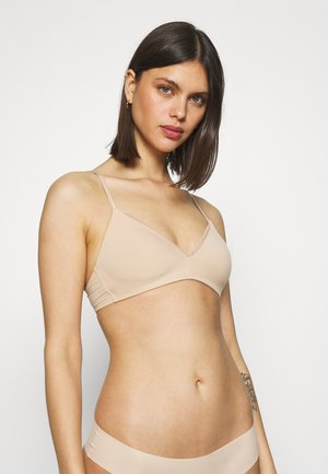 WIRELESS NEW BASIC - Triangle bra - natural nude