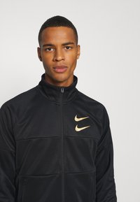 Nike Sportswear - Training jacket - black/gold foil - 3