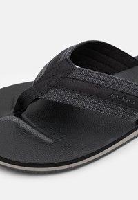 ALDO - DUBOST - Sandály s odděleným palcem - black - 5