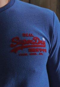 Superdry - VINTAGE LOGO VARSITY - Long sleeved top - mazarine blue marl - 3