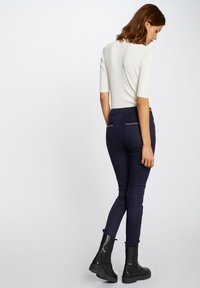 Morgan - WITH WET EFFECT - Trousers - dark blue - 2