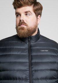 Calvin Klein - LIGHT DOWN LINER - Light jacket - black - 3