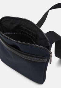 Calvin Klein - FLAT PACK UNISEX - Across body bag - blue - 2