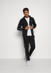 Jack & Jones Performance - JCOZTAPING TRACK SUIT - Chándal - black - 1