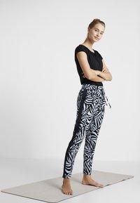 Curare Yogawear - WASSERFALL - Basic T-shirt - black - 1
