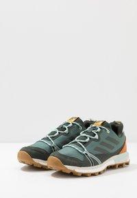 adidas Performance - TERREX SKYCHASER LT - Trail running shoes - legend earth - 2