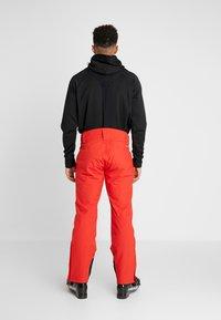 Halti - PUNTTI PANTS - Snow pants - lava red - 2