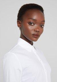 HUGO - EPANTIA - Button-down blouse - open white - 4