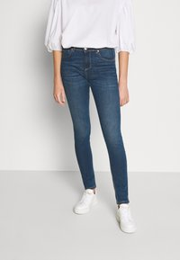 Benetton - TROUSERS - Jeans Skinny Fit - mid blue - 0