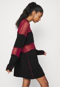 The Ragged Priest - FISHNET SKATER DRESS - Jersey dress - black/red - 6