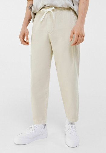 LOOSE - Tracksuit bottoms - nude