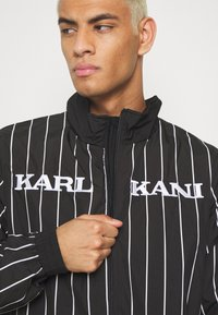 Karl Kani - RETRO PINSTRIPE TRACK JACKET - Veste légère - black - 4