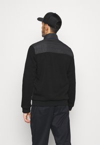 Calvin Klein Golf - HYBRID JACKET - Softshellová bunda - black - 2