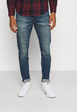 CKJ 058 SLIM TAPER - Jeans Skinny Fit - denim medium