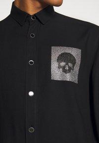 Just Cavalli - SHIRT SPARKLY SKULL - Košile - black - 5