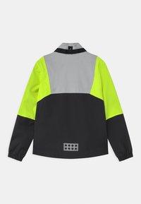 LEGO Wear - JORI UNISEX - Vodotěsná bunda - yellow - 2
