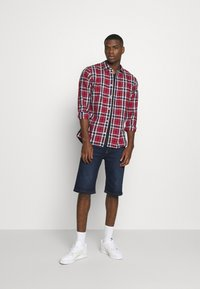 Tommy Jeans - REY RELAXED - Denim shorts - dark-blue denim - 1