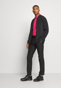 adidas Golf - ULTIMATE SPORTS GOLF PANTS - Kalhoty - black - 1