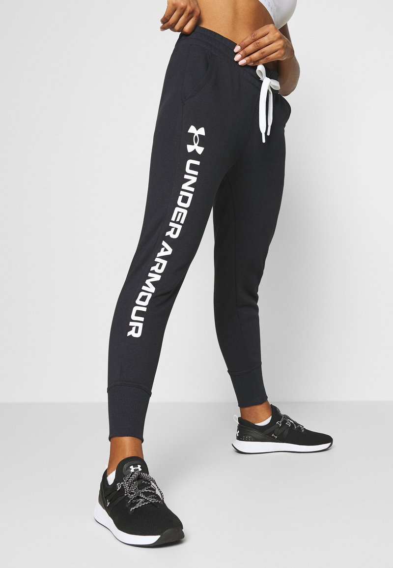 Under Armour - RIVAL SHINE JOGGER - Tracksuit bottoms - black