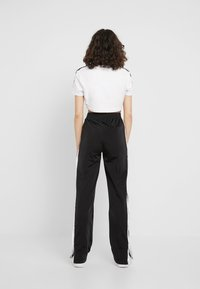 adidas Originals - ADIBREAK PANT - Tracksuit bottoms - black - 2