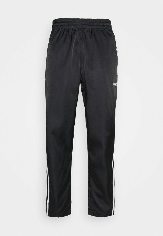 FIREBIRD - Tracksuit bottoms - black/white