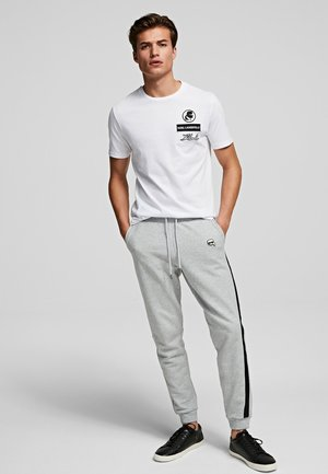 IKONIK - Tracksuit bottoms - grey melange