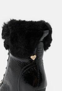 Love Moschino - RUBBER CAP - Enkellaarsjes met hoge hak - black - 6