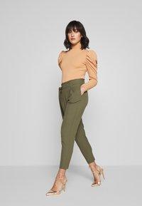 ONLY Petite - ONLNICOLE PAPERBAG ANKEL PANTS - Pantalones - kalamata - 1