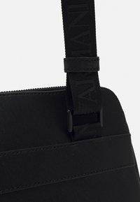 Emporio Armani - MESSENGER BAG - Taška spříčným popruhem - black - 4
