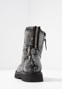 MJUS - Kotníkové boty na platformě - nero - 5