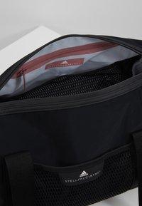 adidas by Stella McCartney - ROUND DUFFEL S - Sports bag - black/black/white - 4