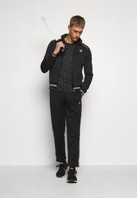 Fila - PANT PIUS - Pantaloni sportivi - black - 1
