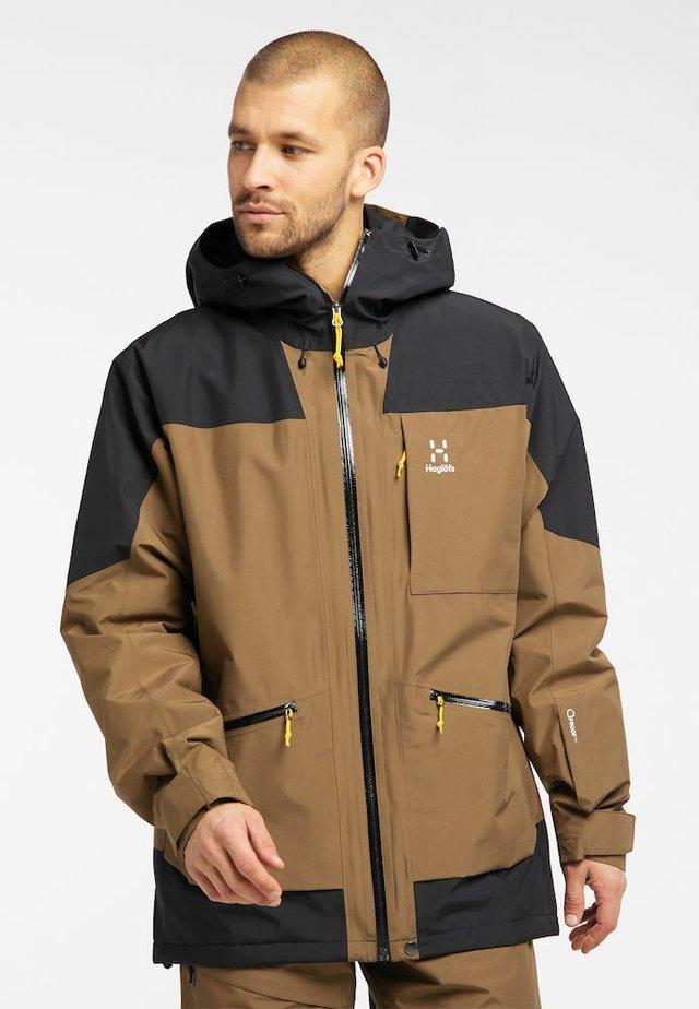 LUMI INSULATED JACKET - Ski jacket - teak brown/true black