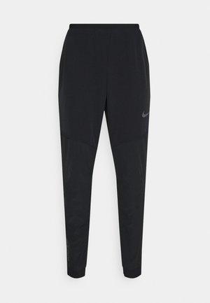 FLEX PANT  - Tracksuit bottoms - black