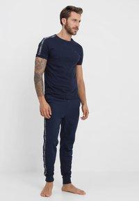 Tommy Hilfiger - TRACK PANT - Pyjama bottoms - blue - 1