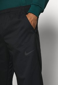 Nike Performance - DRY PANT TEAM  - Tracksuit bottoms - black - 4