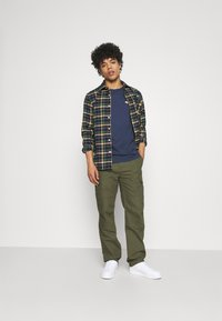 Dickies - MILLERVILLE - Cargo trousers - military green - 1