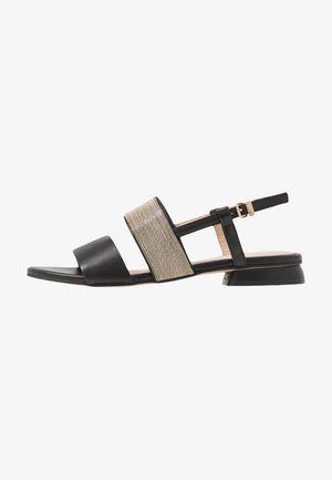 CHAIN STREET - Sandaalit nilkkaremmillä - black