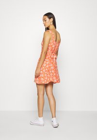 American Eagle - TIE BACK MINI DRESS - Vardagsklänning - red